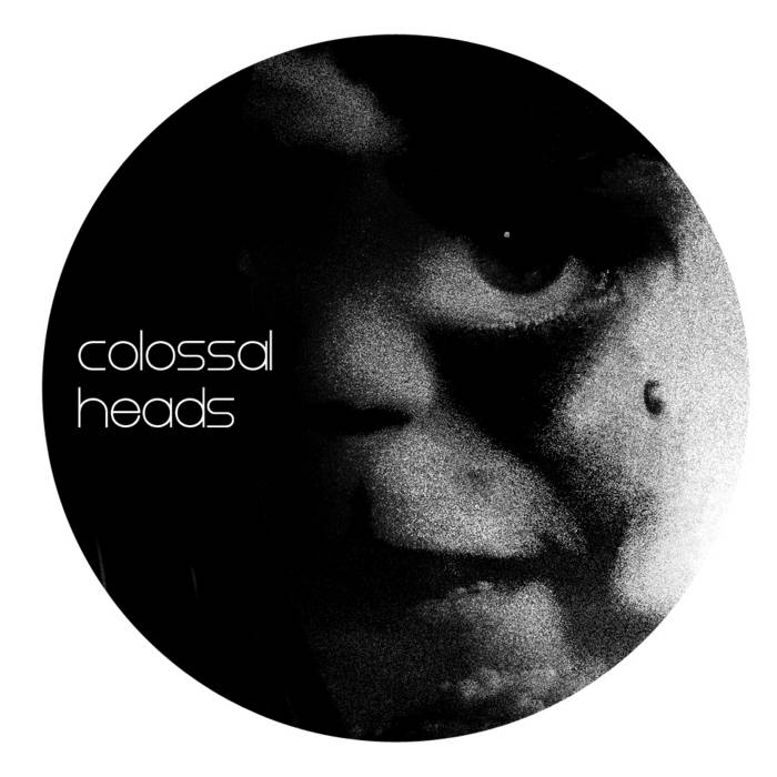 Colossal Heads One cover art